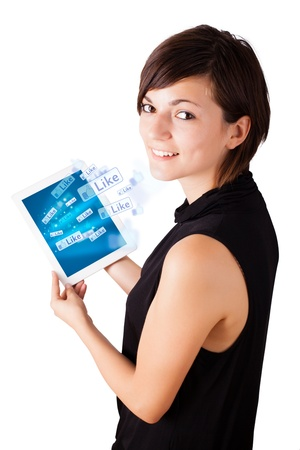 touch pad: Young business woman looking at modern tablet with social icons