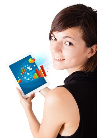 Young business woman looking at modern tablet with colourful diagrams Stock Photo - 16288605