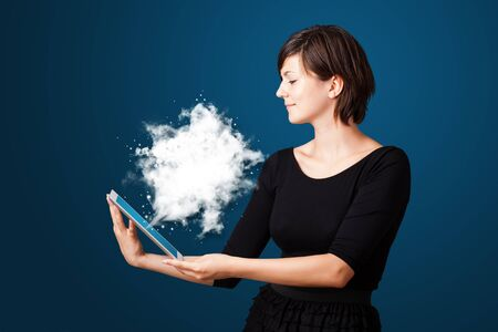 Young business woman looking at modern tablet with abstract cloud Stock Photo - 16243547