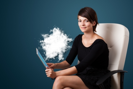 Young business woman looking at modern tablet with abstract cloud Stock Photo - 16245453