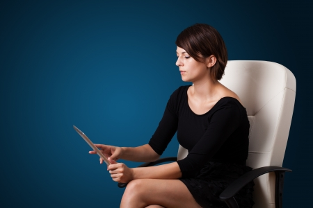 Young business woman looking at modern tablet  Stock Photo - 16243468
