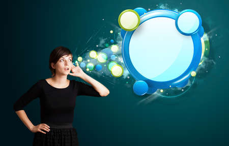 Young business woman with abstract modern speech bubble photo