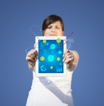 hand holding smart phone: Young business woman looking at modern tablet with abstract light and various diagrams