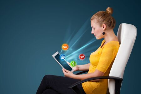 Young business woman looking at modern tablet with abstract lights and various icons Stock Photo - 16287277