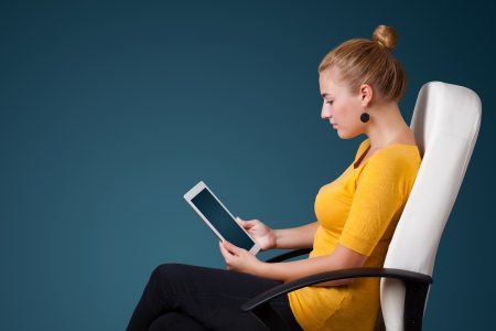 Young business woman looking at modern tablet  photo