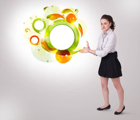 Young business woman presenting abstract copyspace on bright background photo