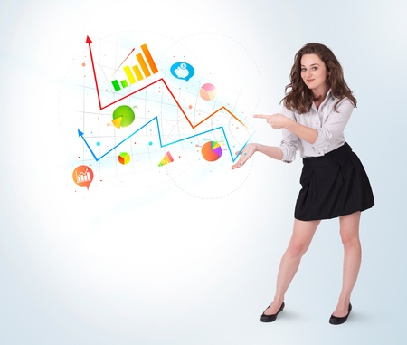 Young business woman presenting colorful charts and diagrams on bright background