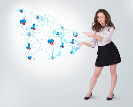 Young business woman presenting social map on bright background photo