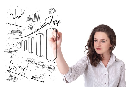 Young business woman drawing various diagrams on whiteboard photo