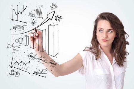 femme dessin: Jeune femme d'affaires dessinant des diagrammes diff�rents sur tableau blanc