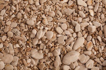 Decorative floor texture with gravel stones photo