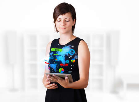 Young business woman looking at modern tablet with colourful technology icons Stock Photo - 16367846