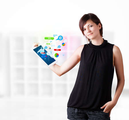 Young business woman looking at modern tablet with colourful technology icons Stock Photo - 16367823