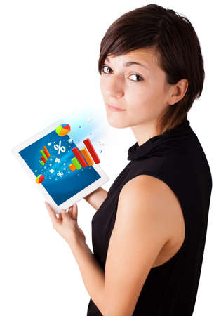 Young business woman looking at modern tablet with colourful diagrams Stock Photo - 16367700