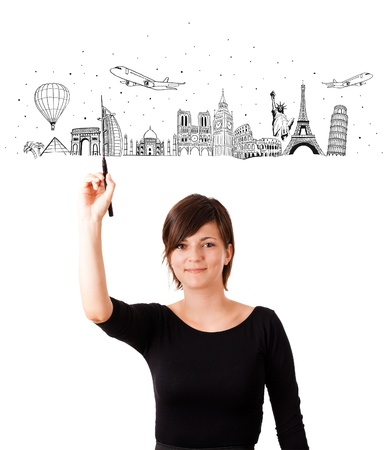 Young woman drawing famous cities and landmarks on whiteboard isolated on white photo