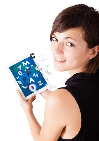 Young business woman looking at modern tablet with alphabet Stock Photo - 16523810