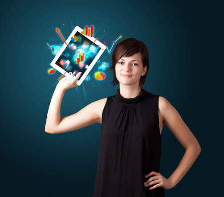 beutiful woman holding modern tablet with colorful diagrams and graphs Stock Photo - 16523866