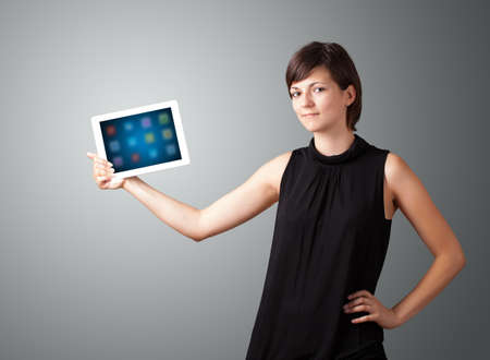 beautiful woman holding modern tablet with colorful icons Stock Photo - 16548267