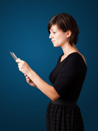 Young business woman looking at modern tablet Stock Photo - 16523893