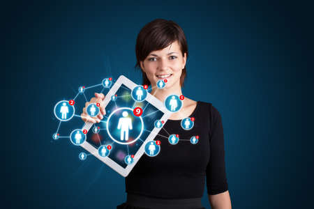 woman tablet: Beautiful young woman holding tablet with social network icons