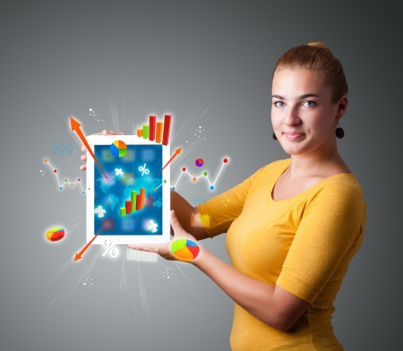 beutiful woman holding modern tablet with colorful diagrams and graphs Stock Photo - 16523903