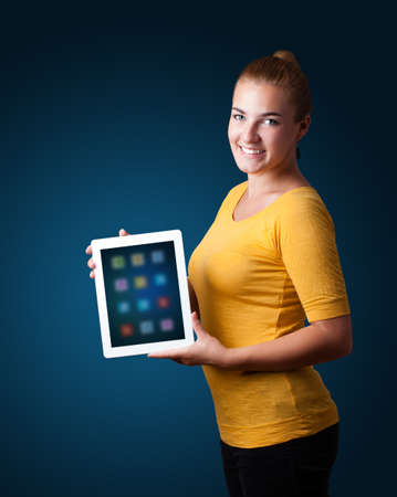 beautiful woman holding modern tablet with colorful icons Stock Photo - 16523912