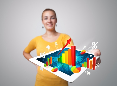 woman tablet: Beautiful young woman holding tablet with colorful graphs and diagrams