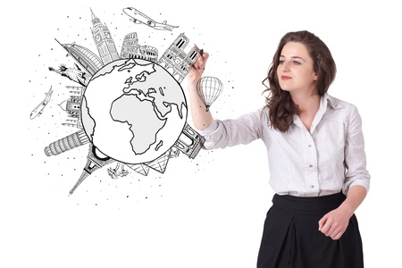 teaching adult: Young woman drawing a globe on whiteboard isolated on white