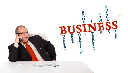 businessman sitting at desk and making phone call with word cloud, isolated on white Stock Photo - 16523843