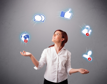 social work: attractive young woman standing and juggling with social network icons Stock Photo