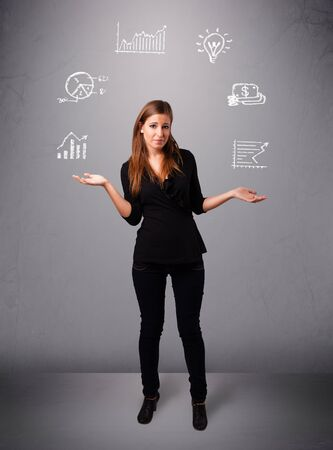 beautiful young woman standin and juggling with statistics and graphs photo
