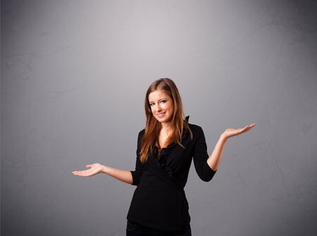 beautiful young lady standing and juggling with copy space photo