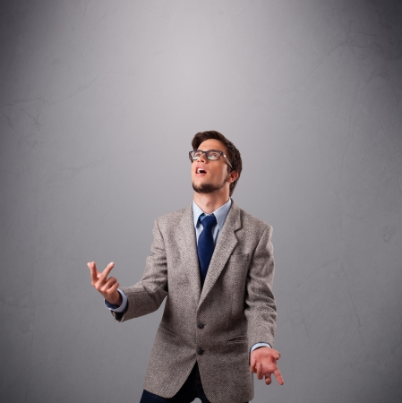 funny man standing and juggling with copy space photo