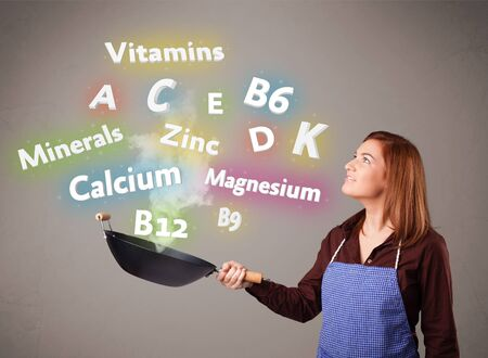 Pretty young woman cooking vitamins and minerals Stock Photo - 16747199