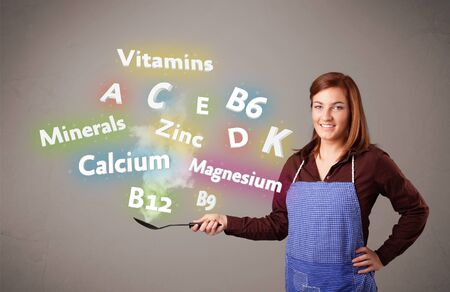 Pretty young woman cooking vitamins and minerals Stock Photo - 16746980