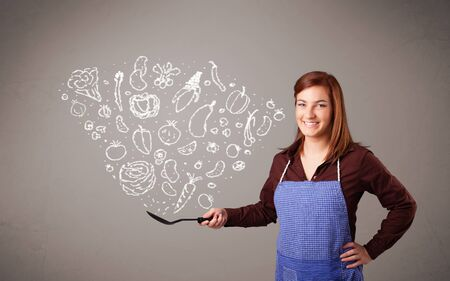 Pretty lady cooking vegetables Stock Photo - 16972997
