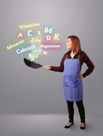 Pretty young woman cooking vitamins and minerals Stock Photo - 16750668
