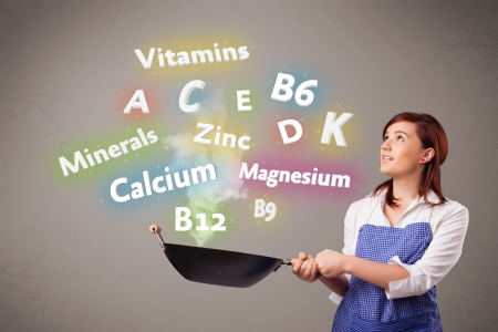 Pretty young woman cooking vitamins and minerals Stock Photo - 16746788
