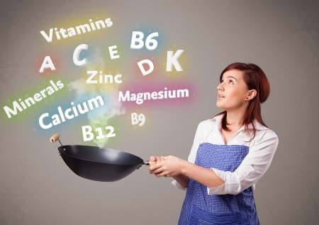 Pretty young woman cooking vitamins and minerals Stock Photo - 16747178