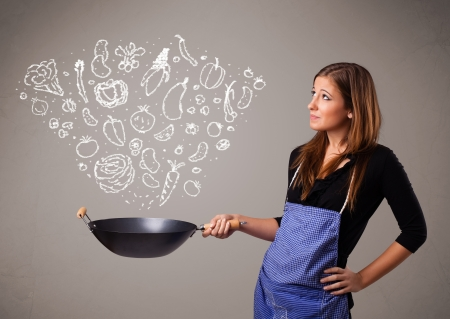 Pretty lady cooking vegetables Stock Photo - 16973030