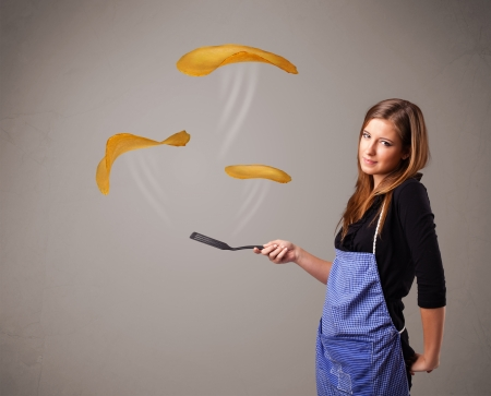 Beautiful young woman making pancakes Stock Photo - 16747166