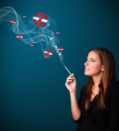 inhale: Beautiful young woman smoking dangerous cigarette with no smoking signs