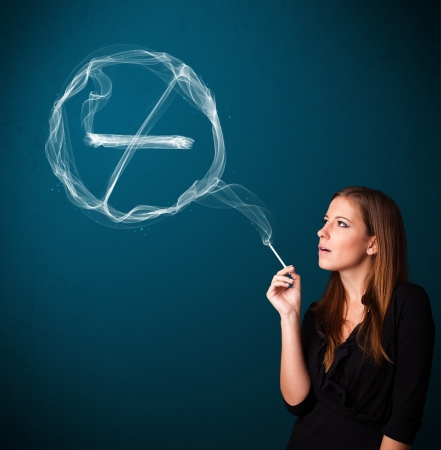 Pretty young lady smoking unheathy cigarette with no smoking sign Stock Photo - 16742353