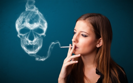 Pretty young woman smoking dangerous cigarette with toxic skull smoke  Stock Photo - 16741960