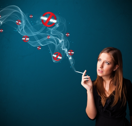 Beautiful young woman smoking dangerous cigarette with no smoking signs Stock Photo - 16742345