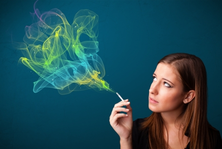 Pretty young lady smoking cigarette with colorful smoke Stock Photo - 16740640
