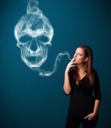 Pretty young woman smoking dangerous cigarette with toxic skull smoke Stock Photo - 16747235