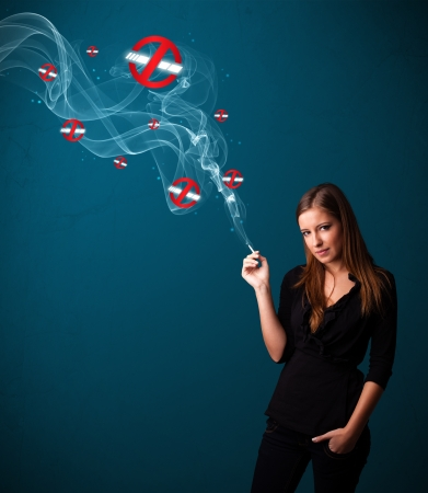 Beautiful young woman smoking dangerous cigarette with no smoking signs Stock Photo - 16742378