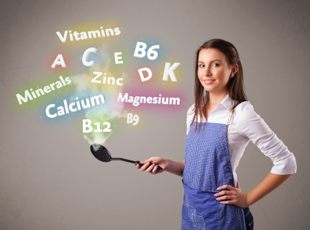 Pretty young woman cooking vitamins and minerals Stock Photo - 16747351
