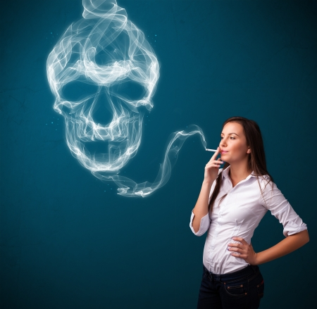 Pretty young woman smoking dangerous cigarette with toxic skull smoke Stock Photo - 16747003
